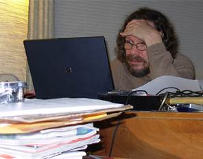 Image of Robert Schoch facing moutains of emails