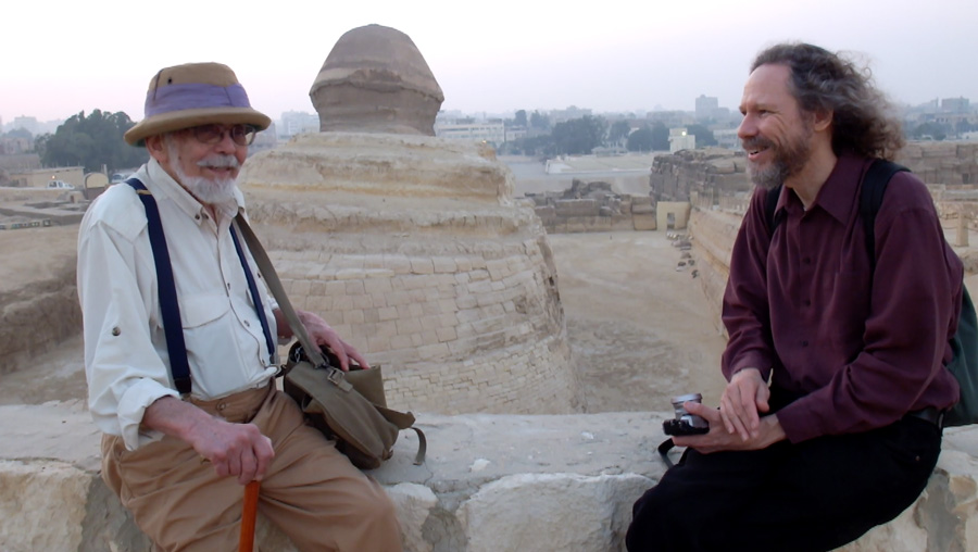 Robert Schoch and John Anthony West sitting in back of the Sphinx