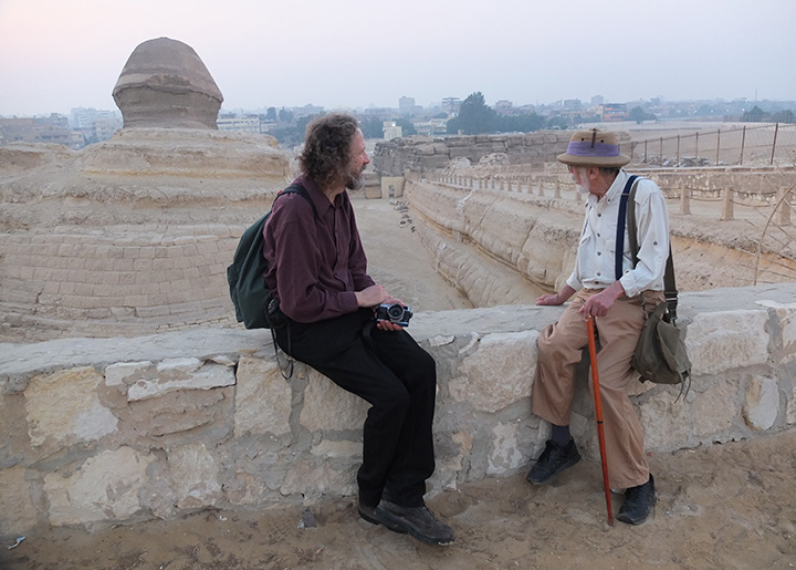 Robert Schoch and John Anthony West sitting together begind the Great Sphinx