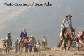 Image of Robert Schoch leading (on horseback) a group to the top  					of the Markawasi Platuea. Photo: Sean Adair