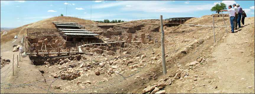 Composite image of Göbekli Tepe (from the southeast looking northwest);  					photos taken in 2010, before this area of the site was covered with a modern  					roof